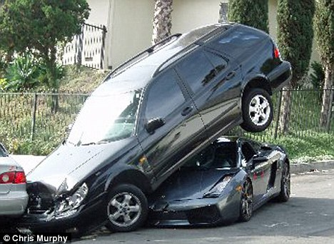 Tight squeeze: The Lambo escaped relatively unscathed in Hollywood