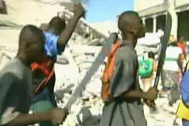men carrying machetes in haiti