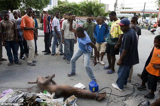 A mob lynch a man accused of robbery in Petion Ville near Port Au Prince, Haiti