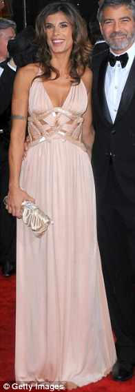 George Clooney (R) and Elisabetta Canalis arrive at the 67th Annual Golden Globe Awards