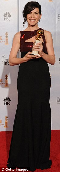 Julianna Margulies poses with her Best Performance by an Actress in a Television Series - Drama award for