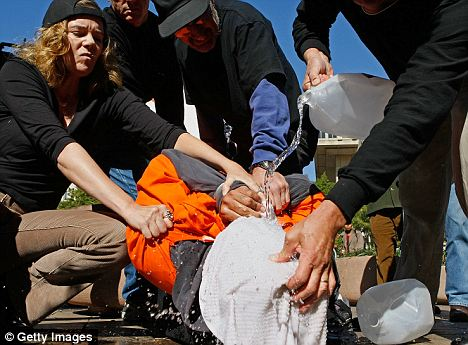 Human rights activists demonstrate waterboarding in front of the Justice Department. A soldier father stands accused of waterboarding his daughter because she couldn't recite the alphabet