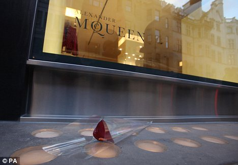 A single rose left outside the Alexander McQueen store in Old Bond Street