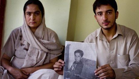 Fawzia Aryan and son Omid with a photo of son Faisal