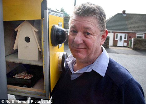 Bird lover: Retired policeman Bill Angus with the bird box, which he says only looks like a speed camera by coincidence