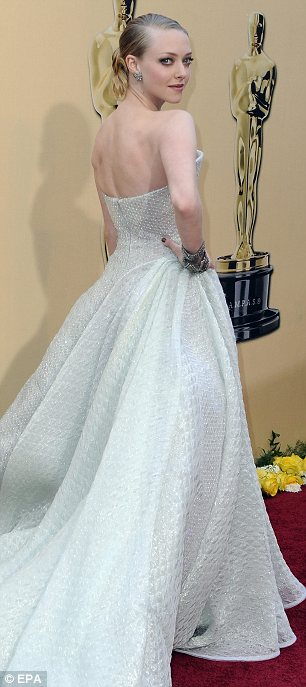Fashion faux pas: Amanda Seyfried and Jennifer Lopez went for incredibly similar Armani Privé gowns