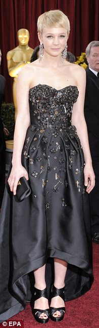 Carey Mulligan's strapless Prada gown was decorated with miniature scissors, spoons and forks