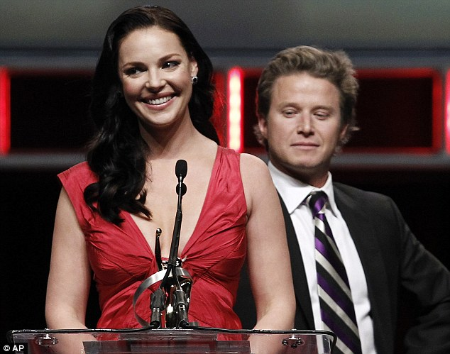Assistance: Host Billy Bush stepped in to hold Katherine's strap in place so she could finish her acceptance speech