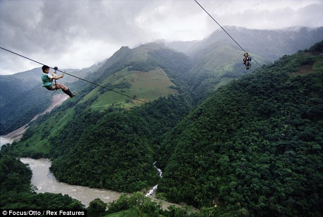 Photo Credit: http://www.dailymail.co.uk/news/article-1259691/The-children-ride-40mph-zip-wire-quarter-mile-high-to-school.html