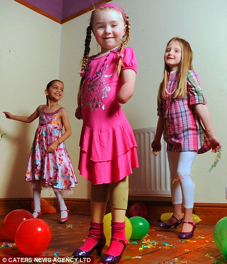 Olivia Story, six, can now dance with her friends at parties in a pair of high-heeled shoes