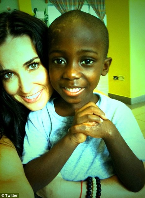 His joyous spirit is still alive! Demi Moore posted a photo of herself with earthquake survivor David - who she met at the St Damian's children's hospital in Port-au-Prince