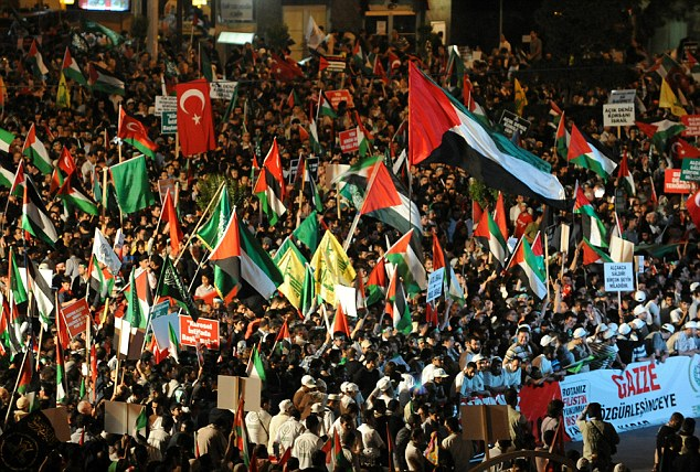 Thousands of demonstrators gather on Taksim Square during a protest against Israel in Istanbul today