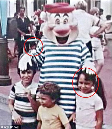 Destiny at Disney World: Alex Voutsinas, pictured in the pushchair in the rear of the photo, and his future wife Donna, front right, were shocked to realise their paths crossed as toddlers