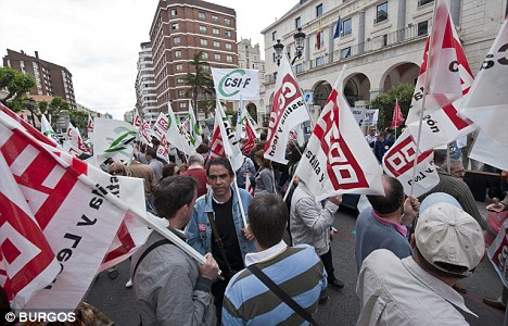 Crisis point: Demonstrators protest cuts announced by the Government in Malaga last week in an echo of the Greek crisis