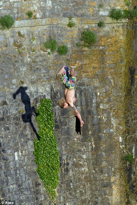 Death-defying: A teenager plunges head first after making the  potentially fatal leap off Dead Man's Cove