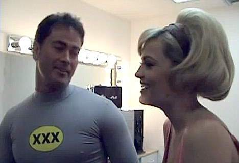Capriati's former boyfriend Dale Dabone claimed the former tennis star had been hysterical over his decision to resume his porn career. Pictured here with an actress on the set of Batman XXX: A Porn Parody