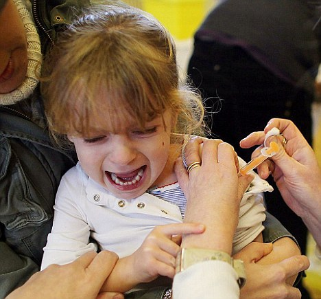 Precaution: A child is vaccinated against swine flu. The Government spent £1.2million addressing the pandemic