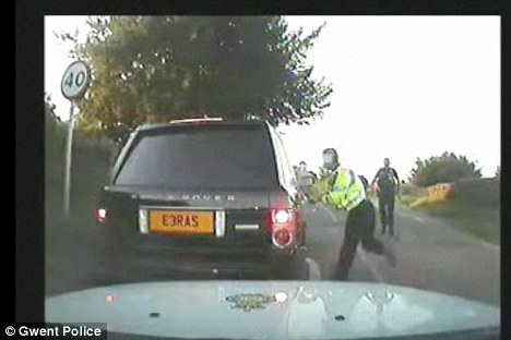 The police video, released by Mr Whatley's solicitor, shows an officer taking a run up with a telescopic 'Asp' baton
