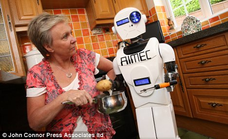 Baked potato anyone? Aimec helps Mrs Ellis in the kitchen