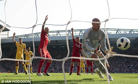 Nightmare: Liverpool goalkeeper Pepe Reina spills the ball into his own net