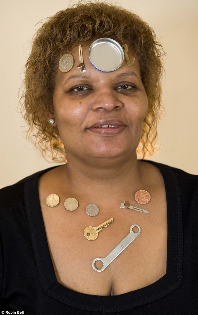 Attraction: Brenda Allison, 50, is so magnetically charged that metal objects including coins, keys and even tin lids stick to her for up to 45 minutes
