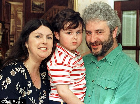 Affected: Robert with his parents as a five-year-old. He is unable to stand, feed himself and speaks very little
