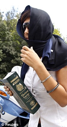 One of the women holding a copy of the Koran arrives for the talk