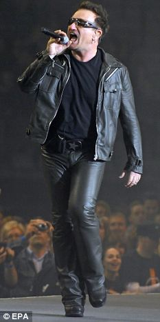 The day job: Bono performs with U2 last night at the King Baudouin stadium in Brussels