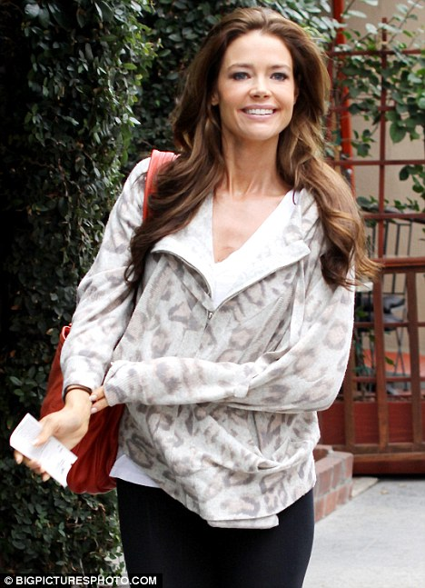 Denise Richards Dyes Her Hair Dark Brown As She Gets Ready