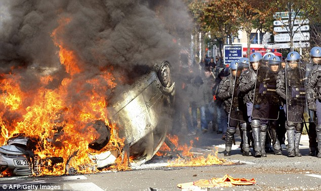 French police officers clash with rioters in Nanterre