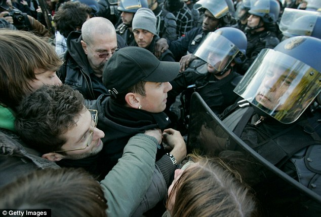 French high school students clash with policemen after a demonstration over pension reform