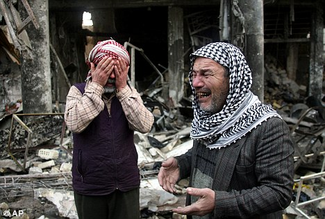 Innocent victims: Baghdad shop owner Abu Abdullah, right, cried following 2007 U.S. bomb strike which killed two of his son