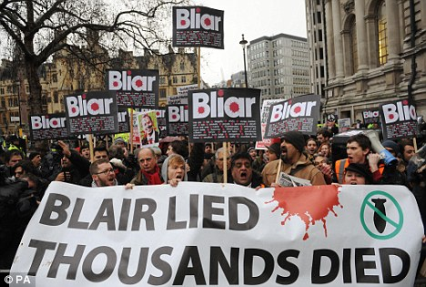 Demonstrators protest outside the Chilcot inquiry