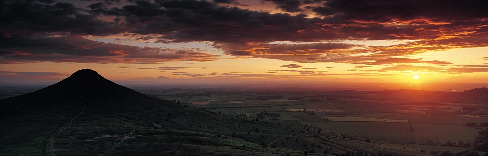 Red sky at night: The summit of Roseberry Topping commands the northern fringe of the North Yorkshire Moors, a lonely sentinel witnessing the going down of the sun