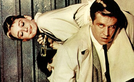 No love lost: Off-screen Audrey thought George Peppard was pompous