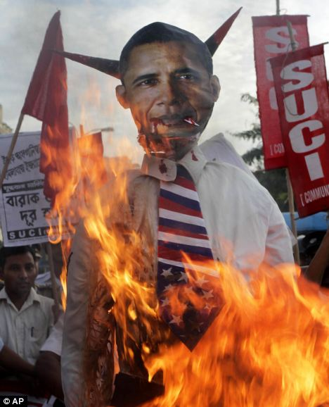 Protest: Members of the Indian Communist Party burn an effigy of President Obama in an anti-war protest