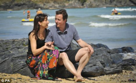 Summer holiday: David Cameron and his wife Samantha on a previous trip to Cornwall
