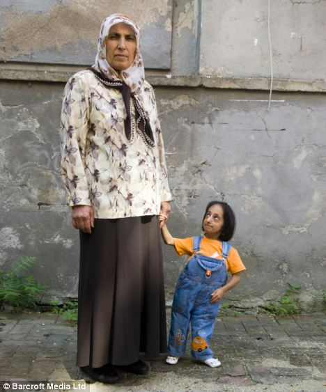 Tiny: The world's smallest woman Hatice Kocaman with her mother Hatun, in Kadirli, Turkey