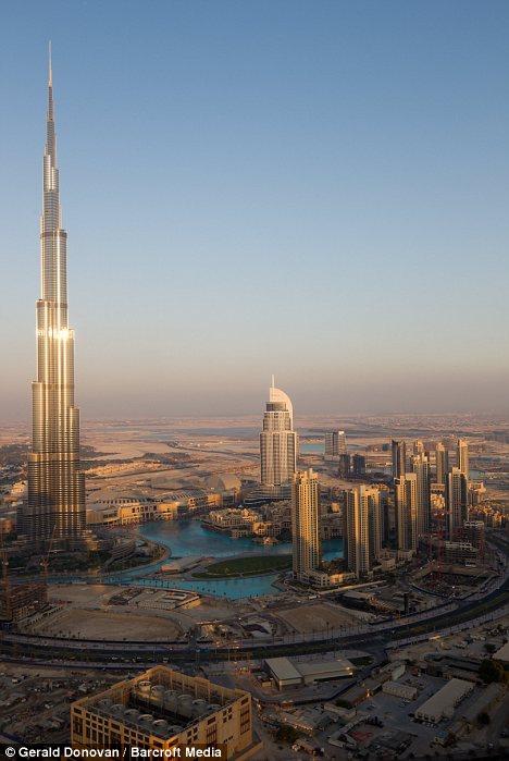High times: A view of the Burj Khalifa showing where Tom Cruise is performing his hair-raising stunt on in Dubai