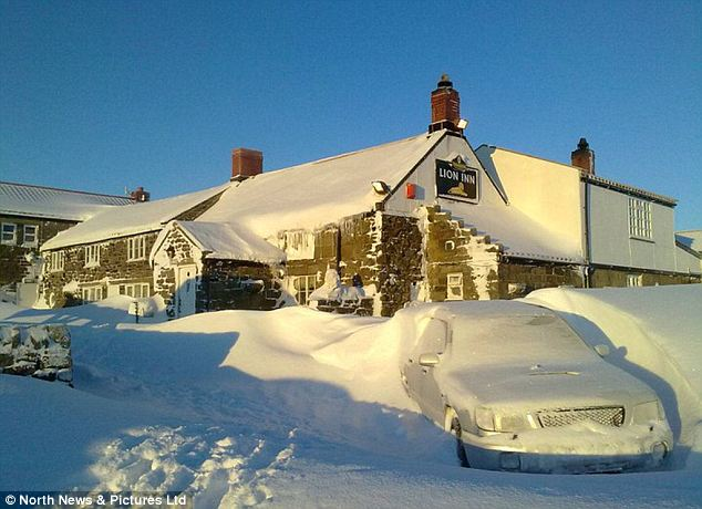 Snowed inn: The Lion Inn pub in Blakey Ridge, North Yorkshire, where seven people have been trapped for nine days