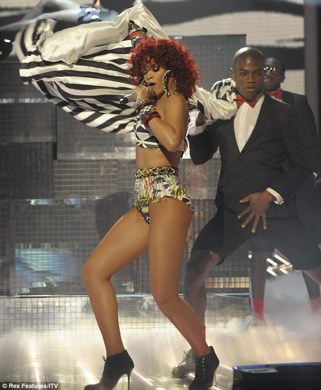 Pre-watershed: Rihanna also set temperatures racing as she stripped down to fishnets, pants and a strapless bra. The performances from the two singers prompted a flood of outraged viewers to take to Twitter