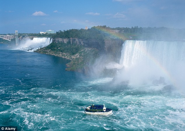 Tourist hotspot: The Maid Of The Mist cruise boat journeys near to the Canadian Falls. The American Falls can be seen in the distance on the left