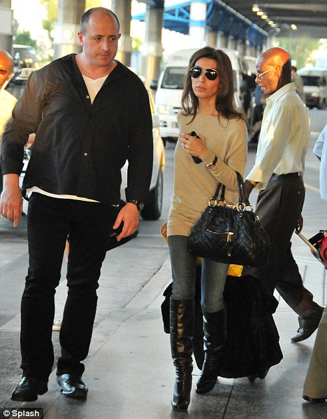 Eager to get there: Accompanied by her driver, Mezhgan walks quickly to her waiting car, keen to start her Christmas holiday with Cowell