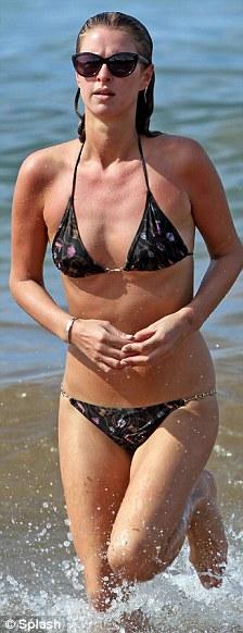 Bikini battle! While Paris wears covers up in a monokini, Nicki shows it all off