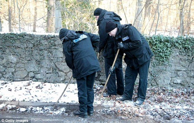 Police search the area where a dead body was discovered at the edge of Longwood Lane yesterday