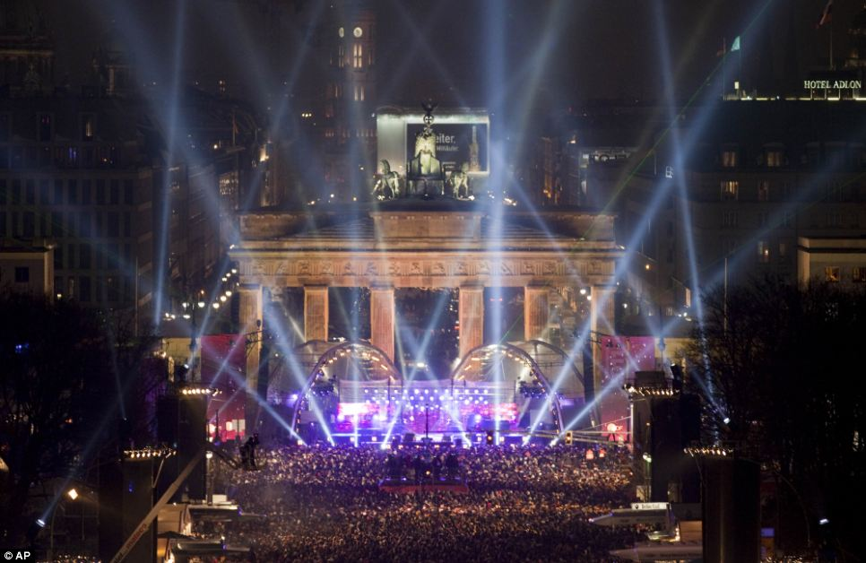 Thousands of people gathered at the Brandenburg Gate in Berlin tonight to welcome in the New Year with a dazzling light show