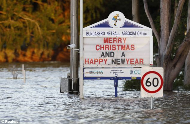 Merry Christmas: But it's far from a happy new year for residents of Bundaberg who are submerged under flood water