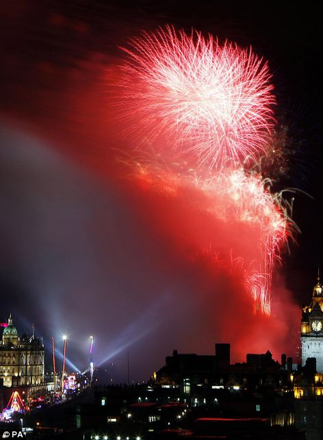 Under a crimson sky: Hogmanay festivities in Edinburgh (left) and Big Ben flanked by the London Eye