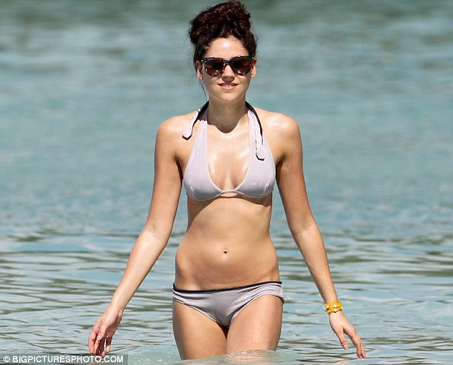Bikini body: The day before, Eliza had taken to the beach wearing a grey bikini