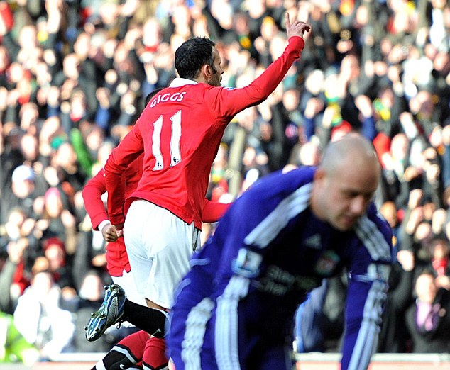 Marching on: Ryan Giggs celebrates his controversial winner to dump rivals Liverpool out of the FA Cup